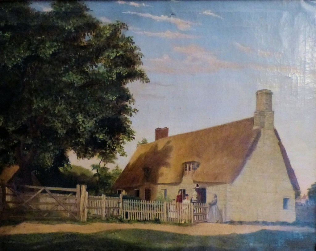 Landscape featuring thatched roof cottage behind fence