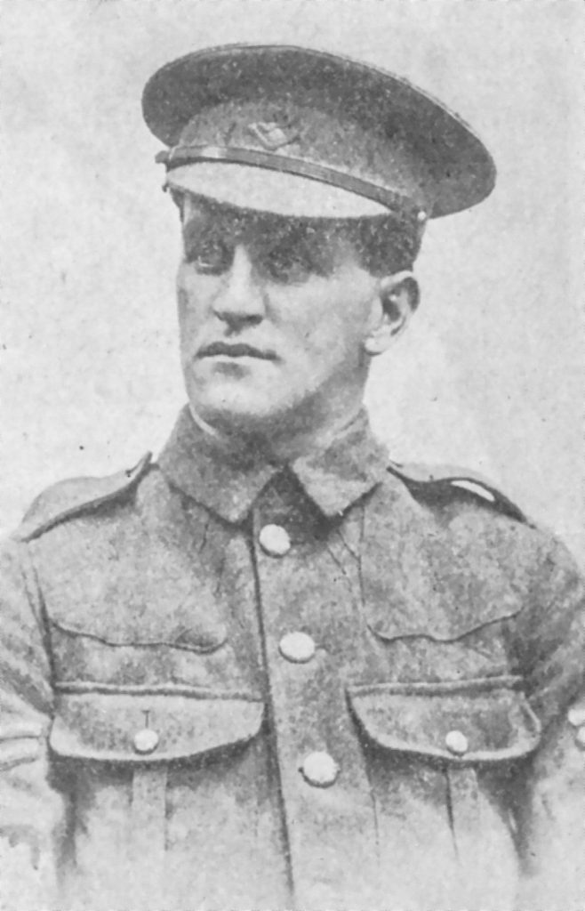 Black and white archival photograph of a man in a uniform wearing a peaked cap.