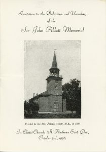 """Front of the invitation to the Sir John Joseph Caldwell Abbott memorial dedication ceremony at Christ Church. The top reads: """"Invitation to the Dedication and Unveiling of the Sir John Abbott Memorial"""" In the centre is a photograph of Christ Church. Below this is the caption: """"Built by the Rev. Joseph Abbott, M.A., 1819"""". The bottom of the invitation reads: """"In Christ Church, St. Andrews East, Que., October 3rd., 1936."""""""
