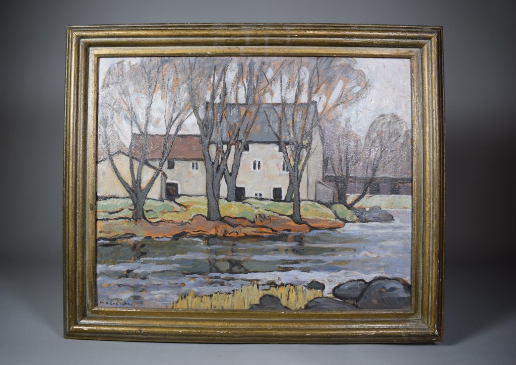 Colour oil painting of a mill on the banks of a river in the fall. It shows the river, trees and the mill. A low gabled building is seen from the back, next to which is the mill in two sections. The first section, on the left, has two floors of grey stone and a rusty gabled roof. The second section, on the right and attached to the first, has three floors and a dark grey gable roof. Behind the mill is a waterfall, a black railway bridge and more trees.