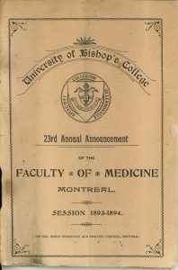 """Cover page of a University of Bishop's College booklet, black ink on sepia paper. A semicircular banner at the top reads """"University of Bishop's College"""". Below the banner is the coat of arms of the University of Bishop's College. The coat of arms is encircled by the words """"Espiscopi Collegium De Lennoxville"""". The following text is displayed under the coat of arms: """"23rd Annual Announcement Of the Faculty of Medicine Session 1893-1894 The Geo. Bishop Engraving and Printing Company, Montreal"""""""