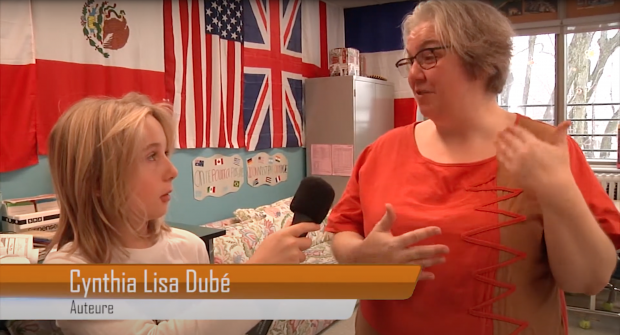 Student interviewing author Cynthia Lisa Dubé in a classroom.