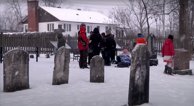 Student group in a cemetery in winter.