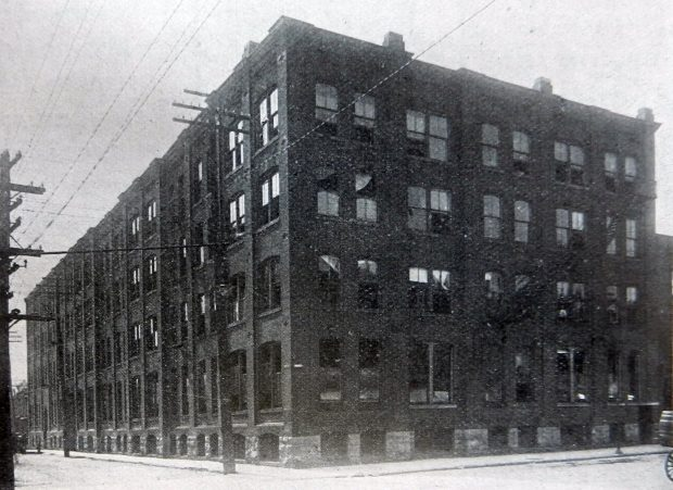 A photograph of John McPherson's four-storey factory, which occupies almost a full city block.