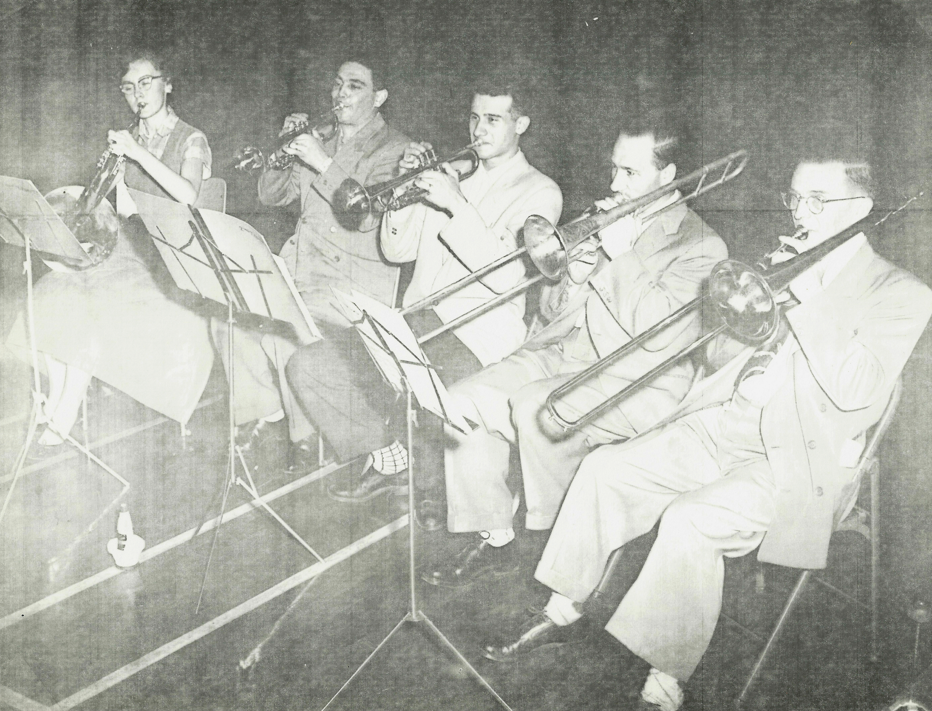5 brass players in rehearsal