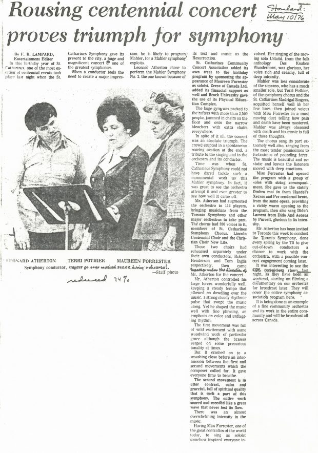 Leonard Atherton, Terri Pothier, and Maureen Forrester look over music on stand. Newspaper article titled Rousing centennial concert proves triumph for symphony