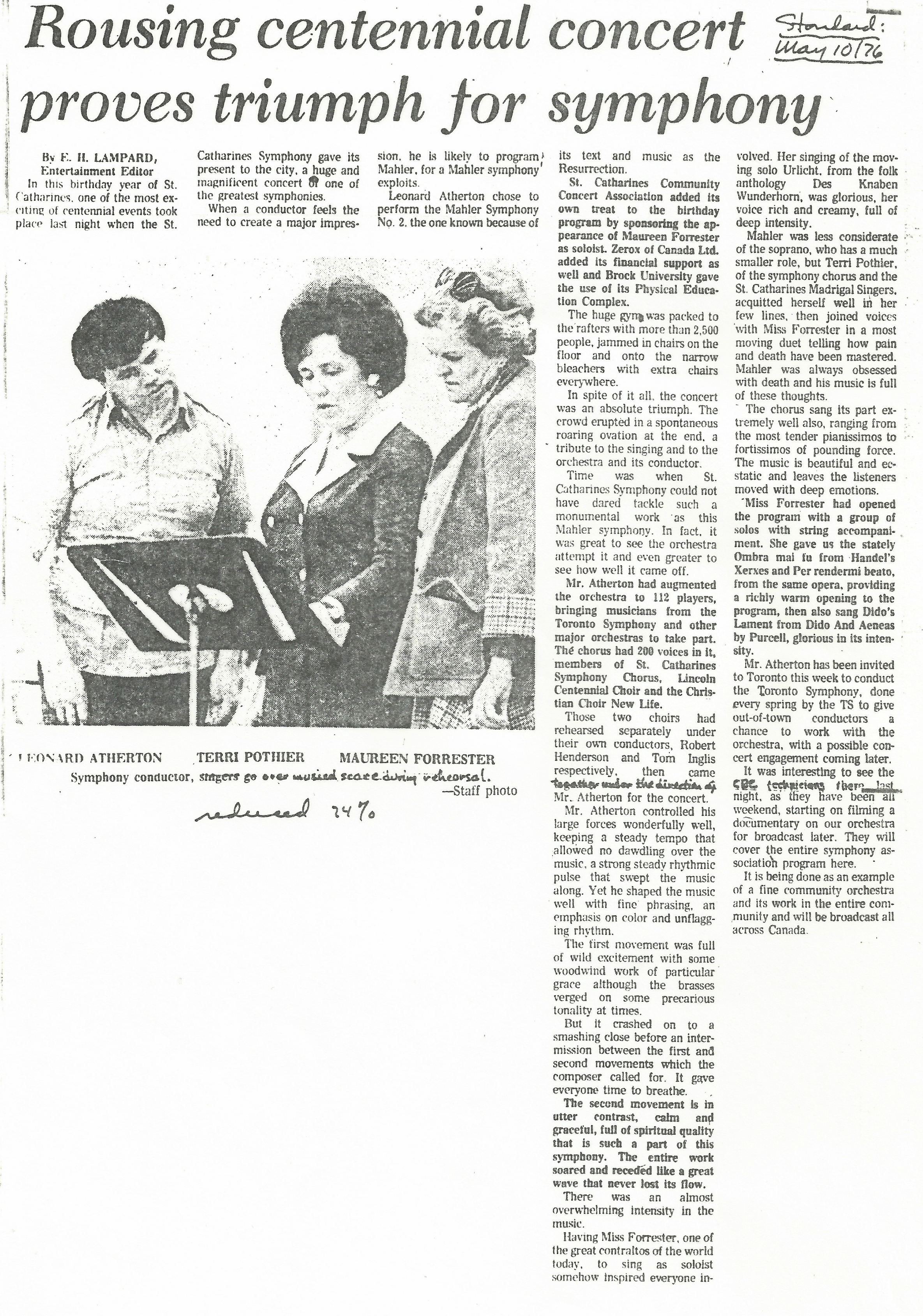 "Leonard Atherton, Terri Pothier, and Maureen Forrester look over music on stand. Newspaper article titled ""Rousing centennial concert proves triumph for symphony"""