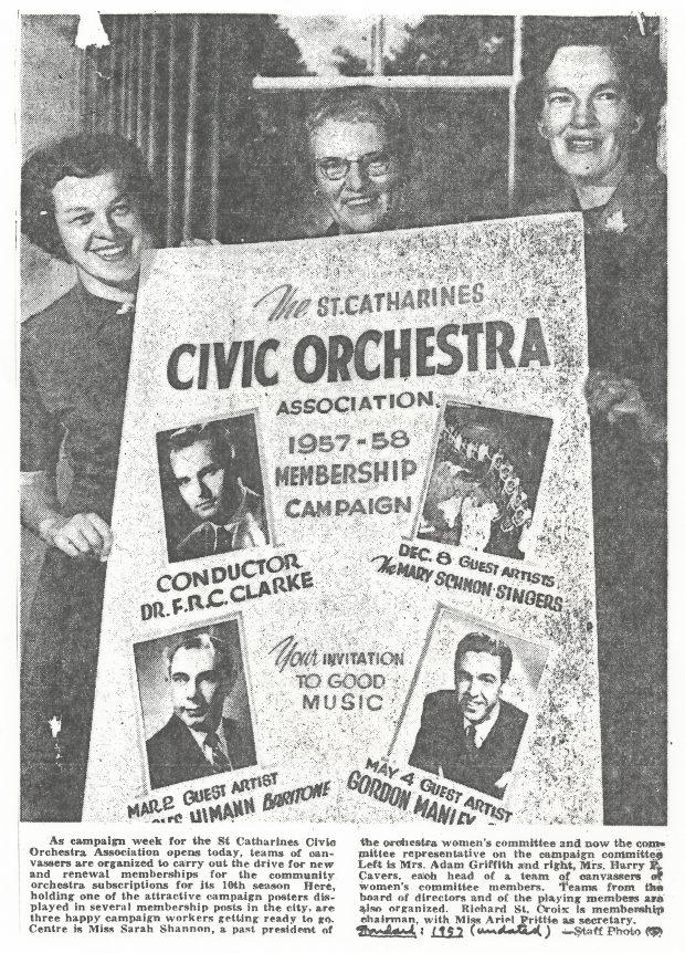 3 members of women's committee hold membership poster