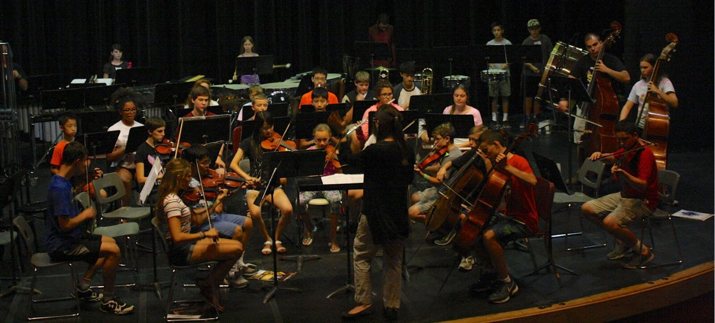 Summer Music Camp orchestra on stage