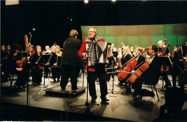 Walter Ostanek plays accordion with orchestra