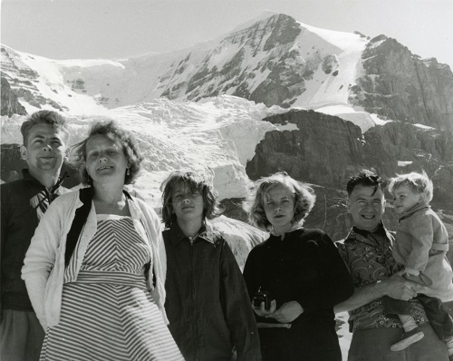 Graham Beard and family posing in front of a large, ice-covered mountain.1959