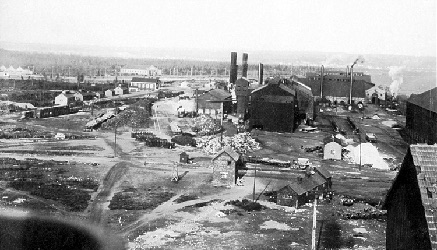 Aerial view of steel plant, smoke stacks and buildings.
