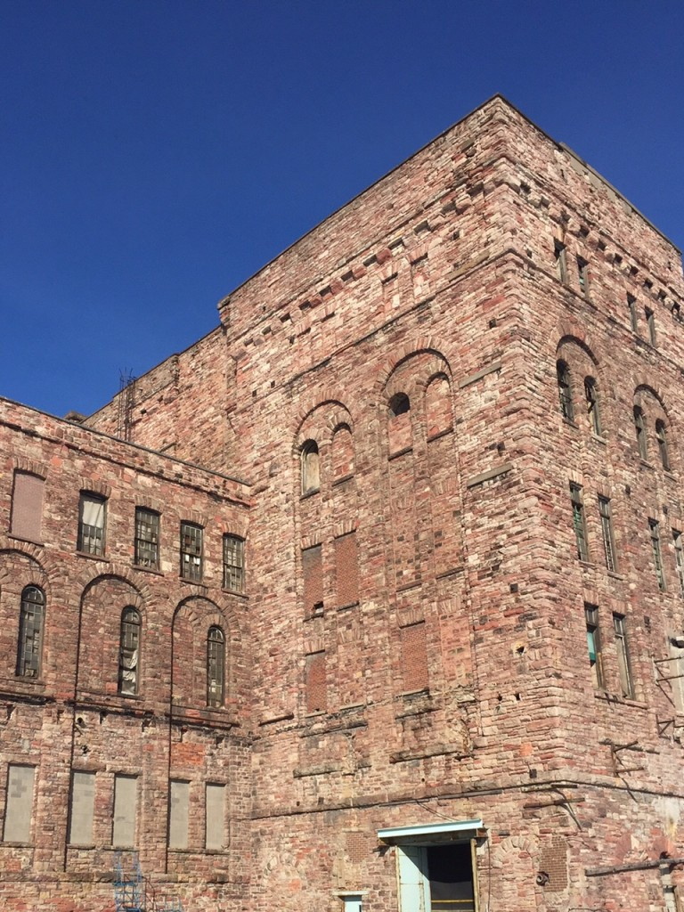 Blue sky in the background, sandstone building tower.