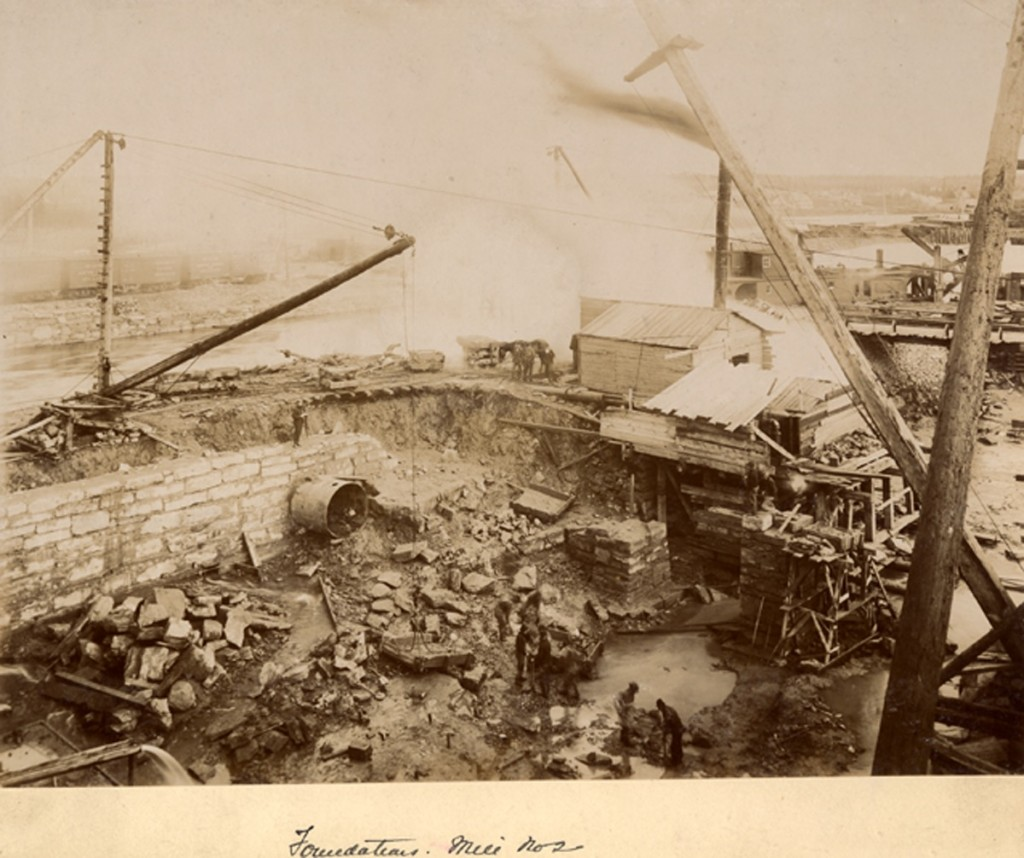 Mill No.2 construction site, foundation of stone mill. Cranes, stone structures, and rubble.