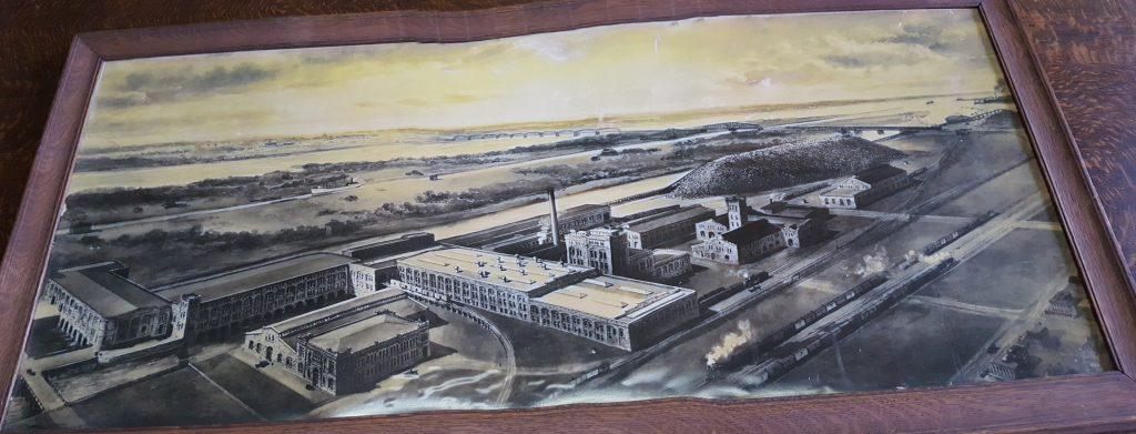 Photograph of a framed concept drawing of the mill.