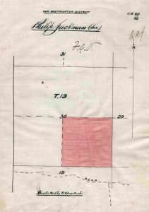 "A government document with a diagram of Philip Jackman's plot of land in Aldergrove. The document shows a pink square parcel of land inside of a larger square. Above the diagram is handwritten text that reads, ""Philip Jackman (Snr.)."""