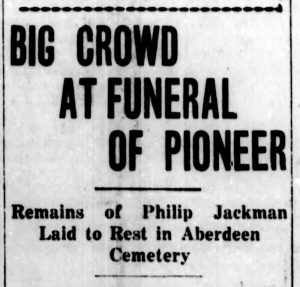 "A newspaper clipping of an article from the October 31, 1927 issue of The British Columbian with a headline that reads, ""Big Crowd at Funeral of Pioneer. Remains of Philip Jackman Laid to Rest in Aberdeen Cemetery."""