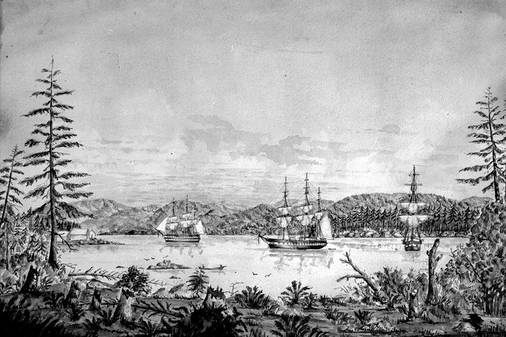 A black and white illustration of the bay at Esquimalt in 1862. The bay is shown from a low perspective along the shore. There are three European ships anchored in the bay with a rolling mountain landscape in the background.