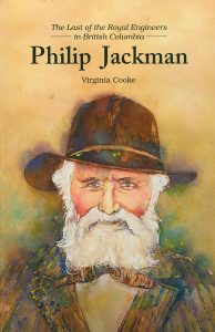 "The cover of the book, ""The Last of the Royal Engineers in British Columbia: Philip Jackman"" by Virginia Cooke. The cover has a watercolour bust portrait painting of a bearded elderly man wearing a brown brimmed hat."