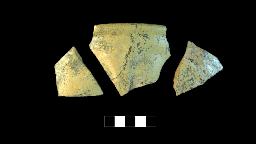Three yellowish ceramic shards