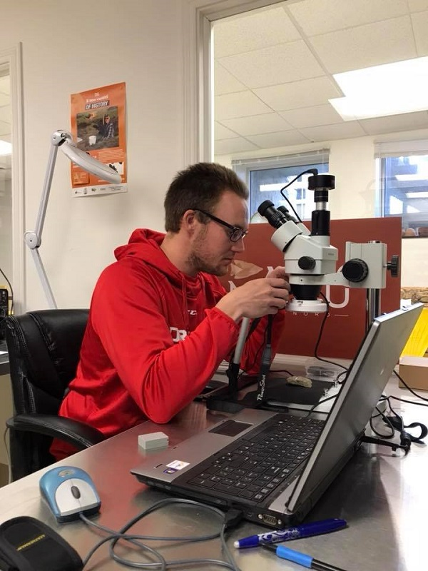 A person using a binocular