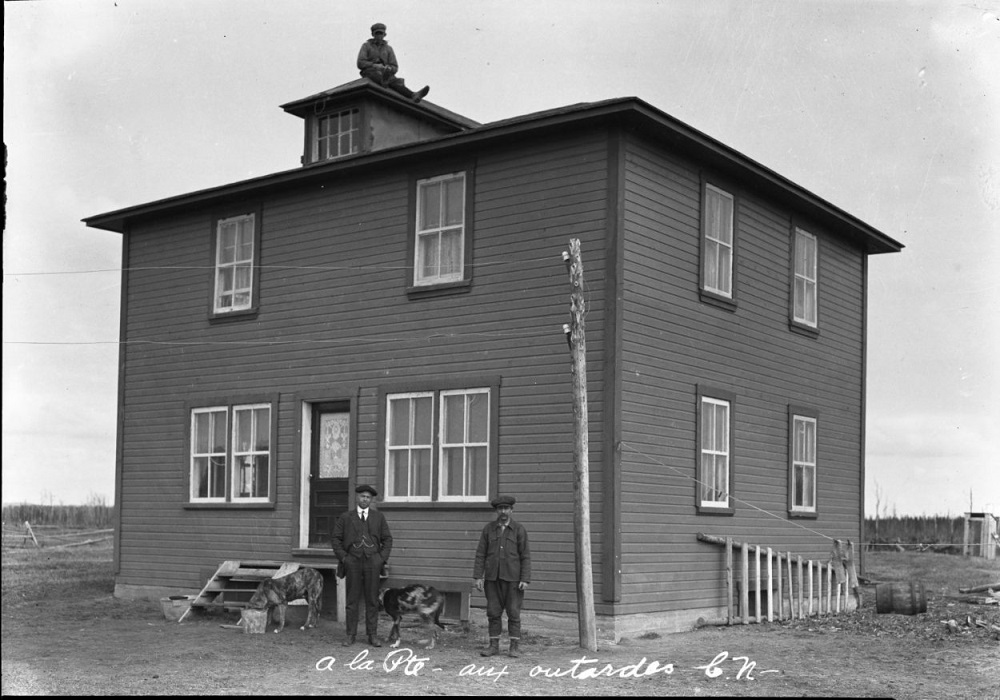 wooden house with three men and two dogs