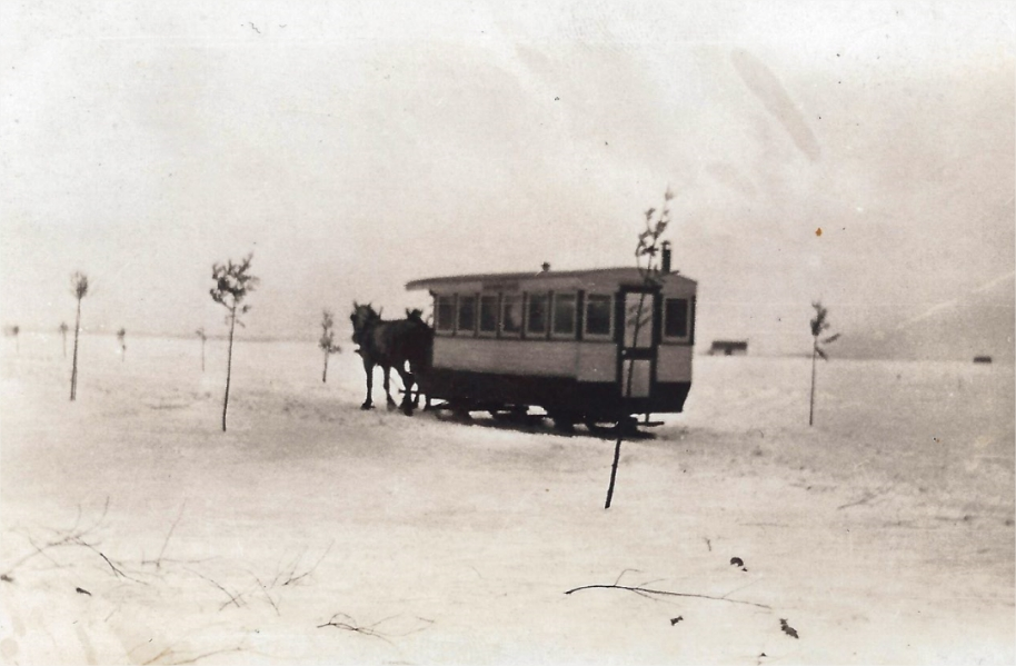 A streetcar drawn by horses on the ice