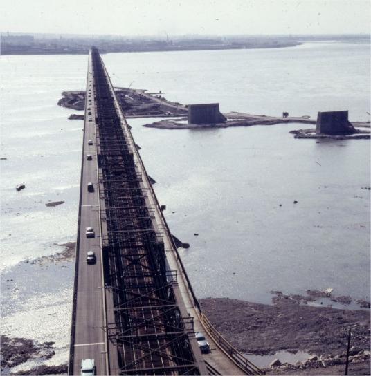 Cars on a bridge with pillars under construction