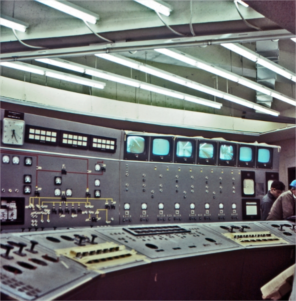 A control room with two men