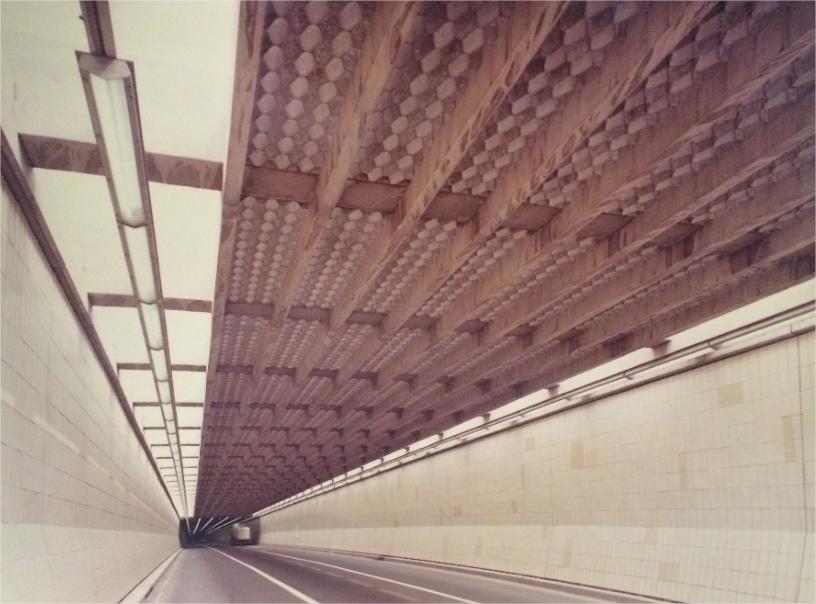 A truck going through a tunnel