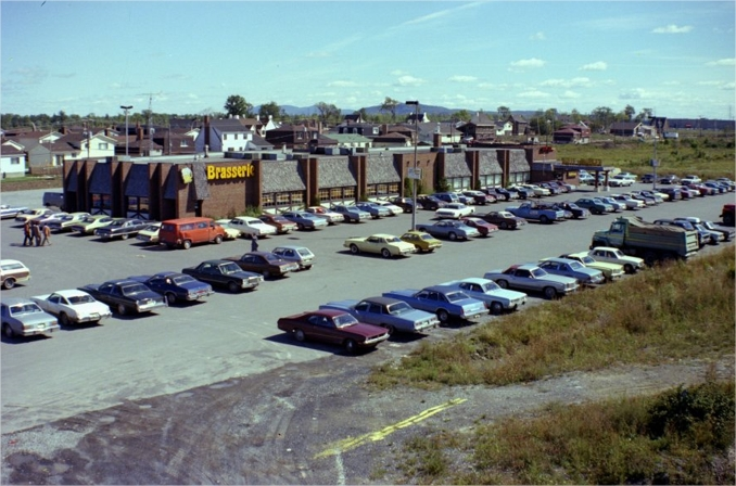 Cars parked in front of a commercial building
