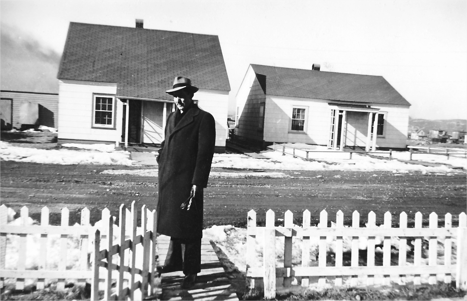 A man in front of single-family homes