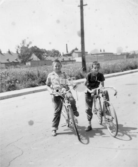 Two children riding their bikes on a Boucherville street