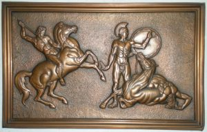 Colour photo of an embossed copper work of art depicting a warrior on horseback wielding a lance as he is poised to attack a helmeted man holding a shield and sword. A third figure is draped over the body of a wounded horse.