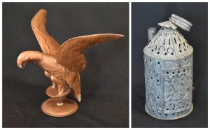 Colour photos showing a copper eagle mounted on a circular stand (left) and a perforated metal candle lantern (right) with a carrying handle on top. There is a small rectangular door on the side and a pipe at the top to insert the candle.