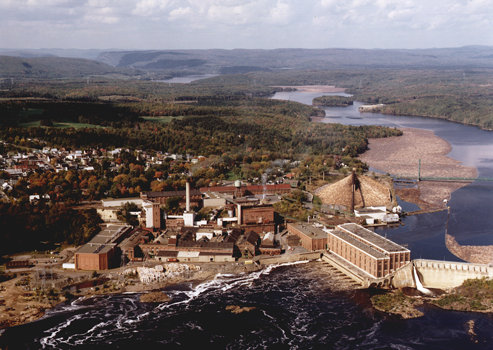 Aerial view of the plant site near the river and the dam