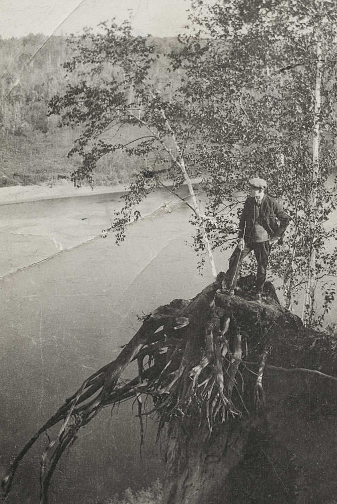 Frank Sutcliffe stands on a stump overlooking the river.