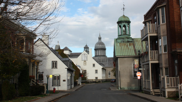 Old buildings frame the narrow street. Two steeples are visible, almost opposite each other.