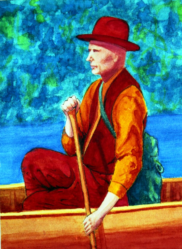 A colourful painting of the famous prospector on a canoe. The background is covered in blue and green, and the man and his canoe are painted in red and yellow.