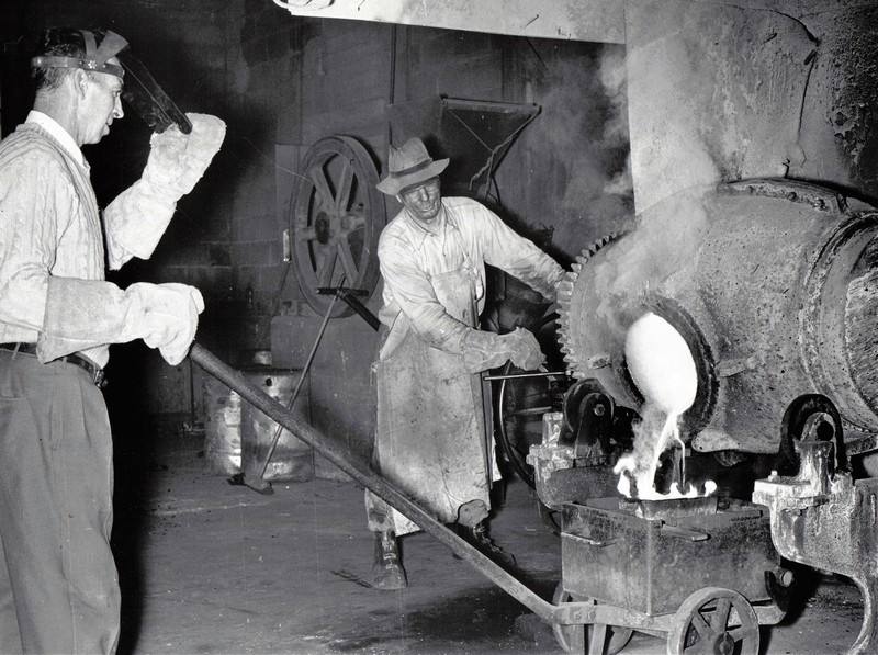 Miner pouring gold