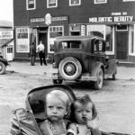 Two children in a stroller in front of the Shannon building in the 1940s