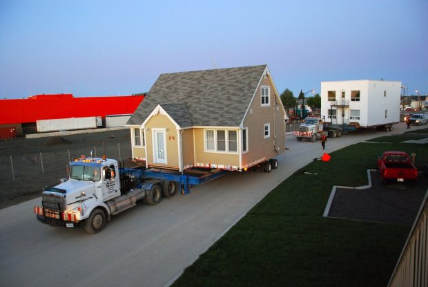 South district relocation: Moving the houses by flatbed trucks