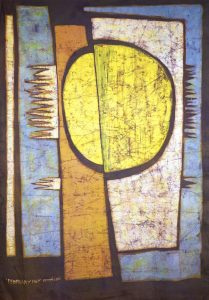 Batiked textile with abstract circle and rectangular designs.
