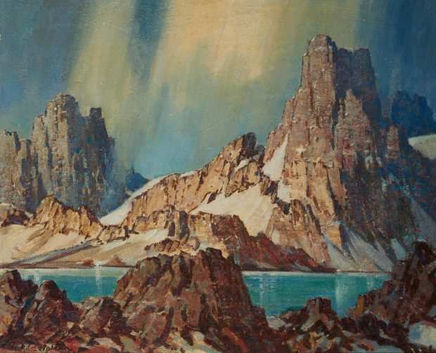 Oil painting of tall mountains and dramatic sky with a lake and rocks in the foreground.