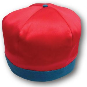Image of a rowing cap worn by the members of the Paris Crew. This replica is made of a satin-like material and pink in colour with blue trim and accents.
