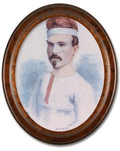 Image of a colourized sketched portrait of Samuel Hutton, a team member of the Paris Crew. There is a high gloss oval wooden frame around the portrait. Hutton is wearing a white long-sleeve shirt, with red buttons and is also wearing their signature rowing cap.
