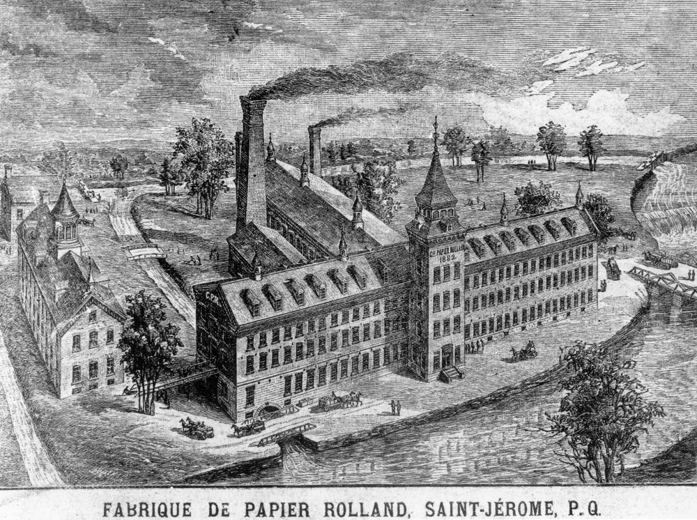 Black & white engraving showing the mill at Saint-Jérôme, beside the Rivière du Nord. The main building, with its tower, as well as the rear wing and smokestacks are seen.