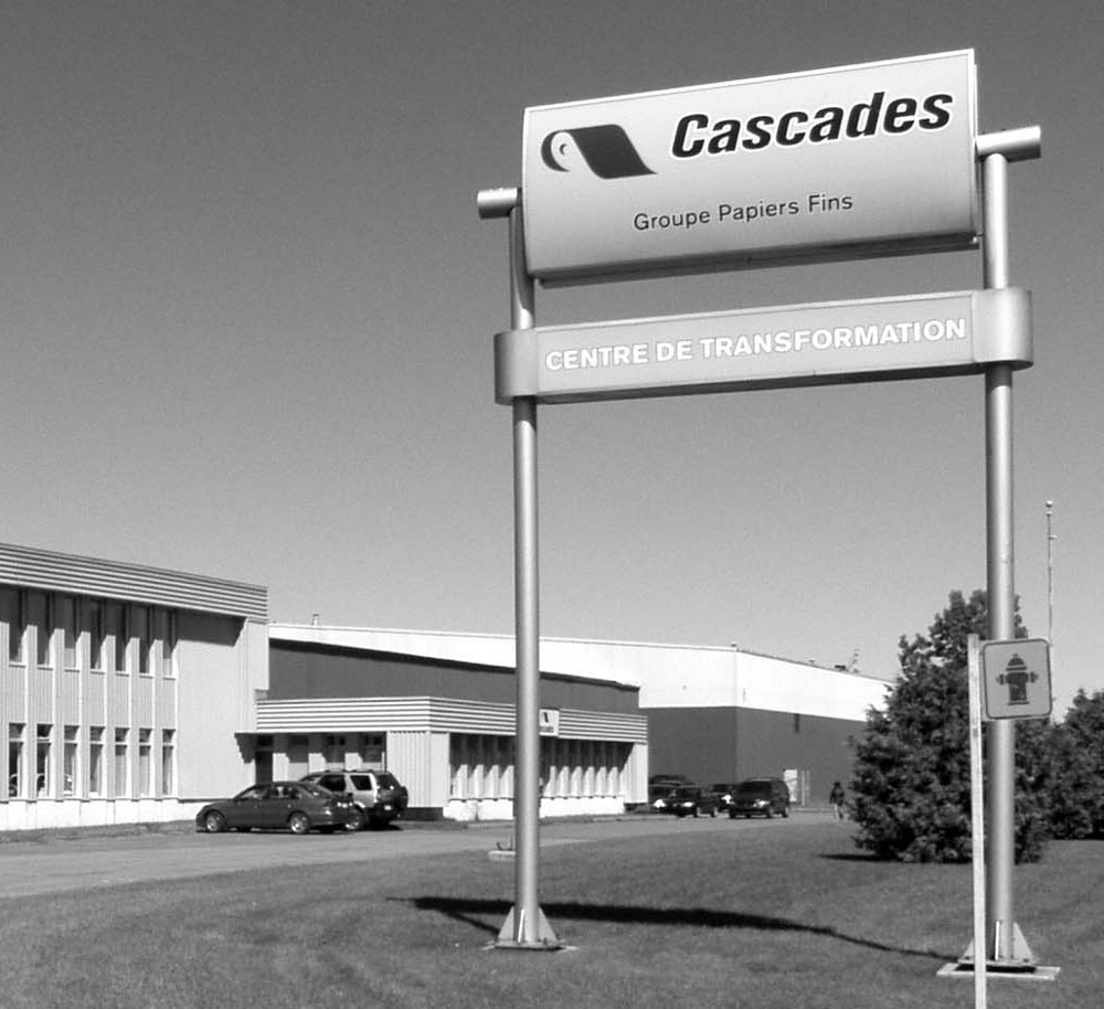 Black & white photograph of the sign in front of the Cascades Converting Centre.
