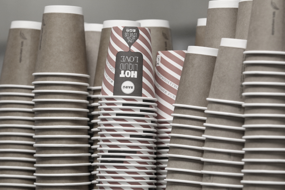 Colour photograph of piles of coffee cups.