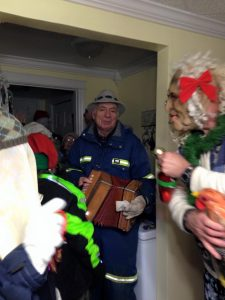 A man plays accordion for the mummers